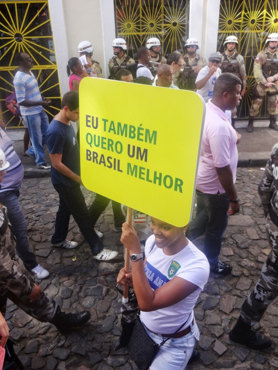 "Spectators, such as Luize, even grabbed demonstrates signs to pose for pictures in support of their cause: ""I also want a better Brasil."""