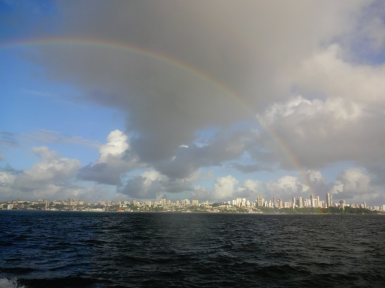 Rainbow arching over Salvador's skyline