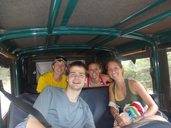 Four brave adventurers in a jeep, ready to hike to Cachoeira da Fumaça!