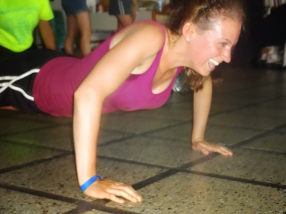 Ha, here I am trying to hop across the room in the position of a push-up.  The mestre literally just bounced--straight as a plank on his hands and tip-toes--across the floor.  I am literally dying because it was pretty much impossible!